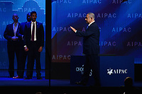 Washington, DC - March 6, 2018: Israeli Prime Minister Benjamin Netanyahu walks about the stage as his security detail stands watch during the 2018 American Israel Public Affairs Committee (AIPAC) Policy Conference at the Washington Convention Center March 6, 2018.  (Photo by Don Baxter/Media Images International)