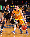 BROOKINGS, SD - DECEMBER 11:  Gabrielle Boever #4 from South Dakota State University pushes the ball past Kaliyah Mitchell #15 from Penn State in the first half of their game Wednesday night at Frost Arena in Brookings. (Photo by Dave Eggen/Inertia)