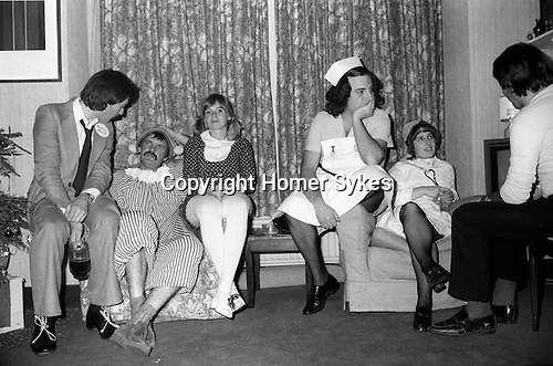 1980's British middle class society. Christmas Fancy Dress Party London. Couples dressed as Andy Pany and in a couple Nurses uniforms.