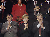 First lady Hillary Rodham Clinton, center, stands and applauds during United States President Bill Clinton's State of the Union Address to a Joint Session of Congress in the U.S. Capitol on January 25, 1994.  With Mrs. Clinton are General Motors Chairman and CEO John Smith, left, and AFL-CIO President Lane Kirkland, right.  Chair of the National Council of Negro Women Dorothy Height, is standing in the row behind Mrs. Clinton.<br /> Credit: Ron Sachs / CNP