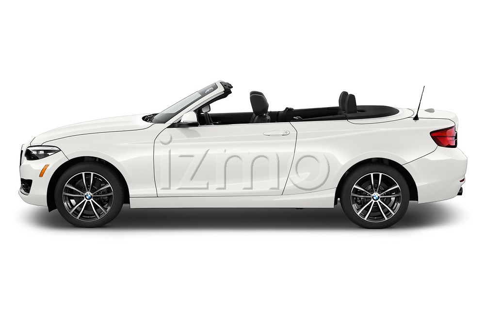 Car driver side profile view of a 2019 BMW 2 Series 230i Sport Line 2 Door Convertible
