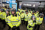 © Joel Goodman - 07973 332324 . 13/05/2013 . Manchester , UK . Police confront 100s of Manchester United fans outside the Manchester City store on Market Street after the Manchester United victory parade , this evening (13th May 2013) Photo credit : Joel Goodman