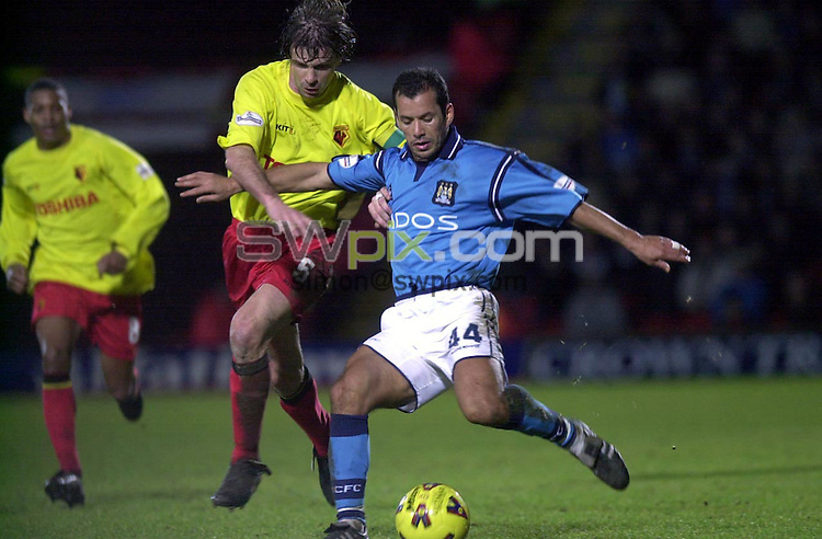 Pix: Matthew Lewis/SWpix.com. Soccer. Nationwide Division One. Watford v Manchester City. 20/01/2002...COPYWRIGHT PICTURE>>SIMON WILKINSON>>01943 436649>>..Man City's Ali Benarbia holds off Watford's Filippo Galli..