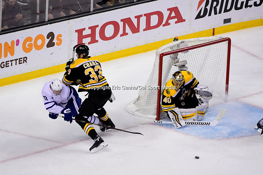 April 21, 2018: Boston Bruins defenseman Zdeno Chara (33) knocks Toronto Maple Leafs center Zach Hyman (11) off his skates during game five of the first round of the National Hockey League's Eastern Conference Stanley Cup playoffs between the Toronto Maple Leafs and the Boston Bruins held at TD Garden, in Boston, Mass. Toronto defeats Boston 4-3, Boston leads Toronto 3 games to 2 in the best of 7 series.