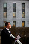 After finishing the final step in setting up his office, Congressman-elect Jim Bridenstine, from Oklahoma's First District, center, gets some fresh air on the balcony of the Rayburn House Office Building in Washington, DC on Nov. 30, 2012.