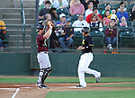SIOUX FALLS, SD - AUGUST 2:  Nick Van Stratten #10 from the Sioux Falls Canaries scores the first run in the first inning as catcher Petey Paramore #25 from the Kansas City T-Bones defends Friday night at the Sioux Falls Stadium. (Photo by Dave Eggen/Inertia)