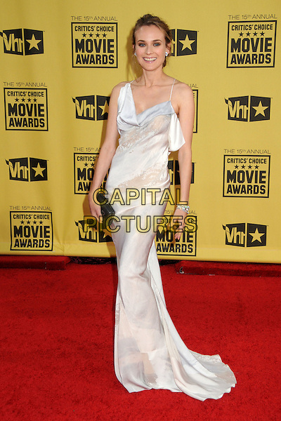 DIANE KRUGER .15th Annual Critics' Choice Movie Awards - Arrivals held at the Hollywood Palladium, Hollywood, California, USA, 15th January 2010..full length long maxi dress hand on hip white black clutch bag bracelet .CAP/ADM/BP.©Byron Purvis/Admedia/Capital Pictures