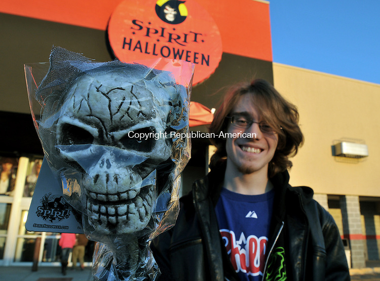 TORRINGTON, CT 25 OCTOBER 2011--102511JS01---Dan Krouse of Barkhamsted with some of his Halloween items outside Spirit Halloween on East Main Street in Torrington on Tuesday. <br /> Jim Shannon Republican-American