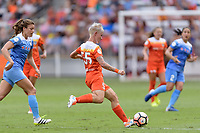 Houston, TX - Saturday April 15, 2017: Janine van Wyk passes the ball during a regular season National Women's Soccer League (NWSL) match between the Houston Dash and the Chicago Red Stars at BBVA Compass Stadium.