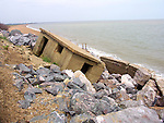 Coastal erosion showing collapse of second world war pill box at East Lane. Bawdesy, Suffolk, England. This view is looking north into Hollesly Bay towards Shingle Street.