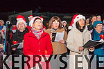 Killarney Musical Society singers l-r: Orna O'Shea, Orlaith Monks and Claire 'Shanahan performing at the Holy Cross Mercy NS lightening of the tree of remembrance on Monday night