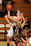 SIOUX FALLS, SD: DECEMBER 10: Ellie Benson #44 from Washington lays the ball up against Allysen Fuller #11 from Sioux City East in the second quarter of their season opener Tuesday night at Washington. (photo by Dave Eggen/Inertia)