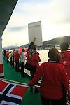 Crew members welcoming other Hurtigruten ferry ship at Molde, Norway