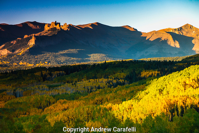 "Ohio Pass located near Crested Butte, Colorado shows off its best fall color as the stone formation aptly named ""The  Castle"" rises on the skyline on the left."