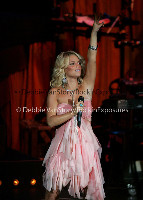 Jessica Simpson performs live during her Reality Tour 2004 at The Pacific Ampitheatre in Costa Mesa,California on July 31,2004 .(Pictured:Jessica Simpson). Copyright 2004 by RockinExposures