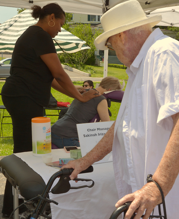 Sakinah Irizarry, offering theraputic massage treatments as part of the Health Day theme, at the Saugerties Farmer's Market on Main Street in the Village of Saugerties, NY, on Saturday, June 10, 2017. Photo by Jim Peppler. Copyright/Jim Peppler-2017.