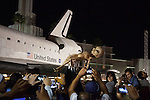 October 13, 2012 - A man holds up a prop alien in the crowd as the Space Shuttle Endeavour makes an overnight stop at Baldwin Hills Crenshaw Plaza on its final move through the streets of Los Angeles to its new home at the California Science Center in Exposition Park.