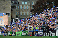 Bath supporters in the crowd celebrate a try. European Rugby Champions Cup match, between Bath Rugby and Toulouse on October 25, 2014 at the Recreation Ground in Bath, England. Photo by: Patrick Khachfe / Onside Images