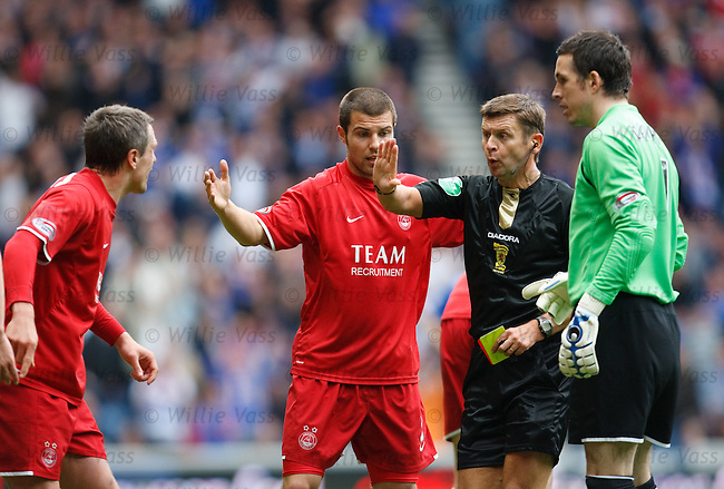Aberdeen players round on referee Stuart Dougal as Charlie Mulgrew is send off