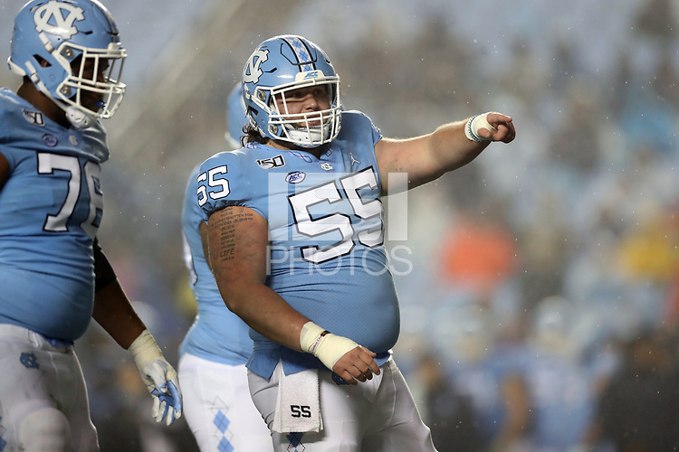 CHAPEL HILL, NC - NOVEMBER 23: Ty Murray #55 of the University of North Carolina points out his blocking assignment during a game between Mercer University and University of North Carolina at Kenan Memorial Stadium on November 23, 2019 in Chapel Hill, North Carolina.