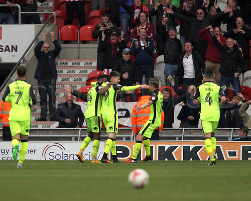 April 29th 2017, Doncaster, South Yorkshire, England; Skybet League 2 football, Doncaster Rovers versus Exeter City; Liam McAlinden of Exeter City celebrates with his team mates after scoring in the 86th minute to make it 1-3