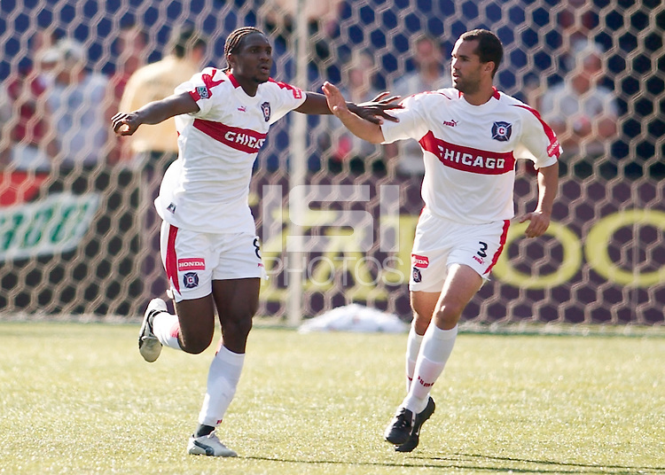 Damani Ralph of the Fire celebrates scoring a goal with team mate Evan Whitfield. The Chicago Fire defeated the NY/NJ MetroStars 2-1 on 8/24/03 at Giant's Stadium, NJ..