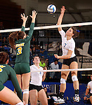 BROOKINGS, SD - OCTOBER 26:  Tiara Gibson #7 from South Dakota State tries for a kill past Emily Minnick #3 from North Dakota State in the third game of their match Saturday evening at Frost Arena in Brookings. (Photo by Dave Eggen/Inertia)