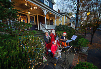 Young neighborhood children playing their musical instruments entertain the passing crowds with Christmas music, at the annual Fourth Ward Holiday Home Tour in Uptown Charlotte, North Carolina. This walkable, self-guided tour allows visitors to get into the Christmas holiday spirit while checking out the beautifully decorated home in Charlotte's historic Fourth Ward.  <br /> <br /> Charlotte Photographer - PatrickSchneiderPhoto.com