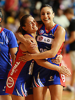 """20.03.2010 Mystics Temepara George and Joline Henry celebrate after the ANZ Champs Netball match between the Mystics and Thunderbirds at Trusts Stadium in Auckland. Mandatory Photo Credit ©MBPHOTO. """"FREE FOR EDITORIAL USE"""""""