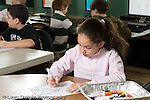 Education Elementary school Grade 2 science special female student at work on table in foreground students at work on computer in background horizontal