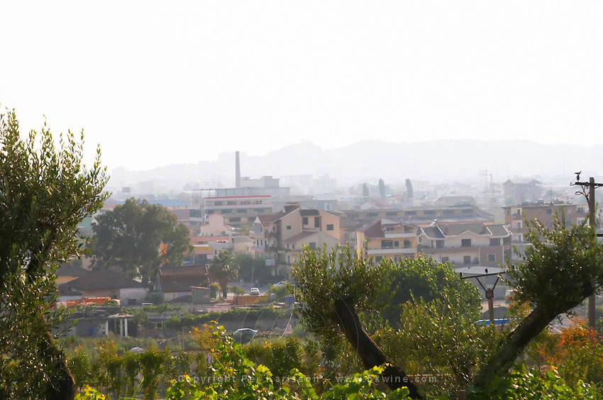 View over rooftops in Durres in hot hazy summer weather. Durres on the coast. Albania, Balkan, Europe.