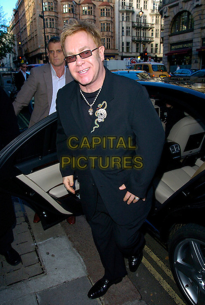 ELTON JOHN.The Old Vic Theatre Fundraiser VIP lunch, 50 St. James restaurant, London, UK..November 21st, 2006.full length black suit jacket sunglasses shades car.CAP/CAN.©Can Nguyen/Capital Pictures
