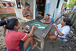 Indigenous women play cards in the Nacoes Indigenas neighborhood in Manaus, Brazil. The neighborhood is home to members of more than a dozen indigenous groups, many of whose members have migrated to the city in recent years from their homes in the Amazon forest.