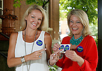 NWA Democrat-Gazette/DAVID GOTTSCHALK - 5/28/15 - Katie Tennant (left) and Sarah Sparks Diebold display the stickers used by Fayetteville Future Fund/Fayetteville Area Community Foundation Thursday May 28, 2015 in Fayetteville.