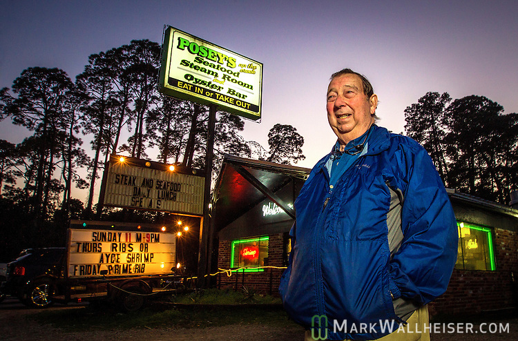 Restauranteur Noah Posey Sr. in front of his restaurant Posey's Seafood Steam Room and Oyster Bar in Panacea, Florida in Wakulla County, Florida.
