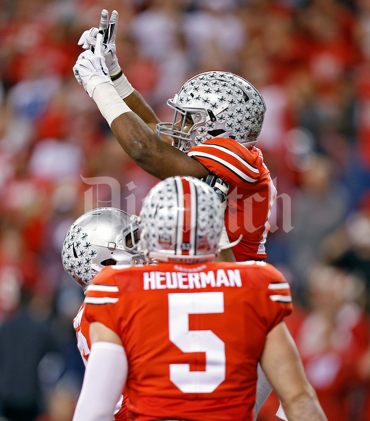 Ohio State Buckeyes running back Ezekiel Elliott (15) celebrates his touchdown run against Wisconsin Badgers during the 1st quarter in the 2014 Big Ten Football Championship Game at Lucas Oil Stadium in Indianapolis, Ind. on December 6, 2014.  (Dispatch photo by Kyle Robertson)