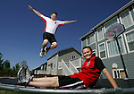"Chris Fushimi (cq) jumps on the trampoline with his son, Jordan (cq), 11, in their backyard in Brighton, Colorado.  Jordan nominated his dad Chris for the ""My Dad is a Hero"" award. (ELLEN JASKOL/ROCKY MOUNTAIN NEWS).**Chris and Jordan Fushimi (cq)"