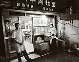 CHINA, Hangzhou, portrait of chefs standing outside a kitchen (B&W)