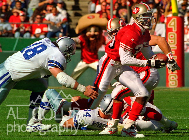 San Francisco 49ers vs. Dallas Cowboys at Candlestick Park Sunday, November 13, 1994.  49ers beat Cowboys 21-14.  San Francisco 49ers defensive back Merton Hanks (36) runs after intercepting ball.