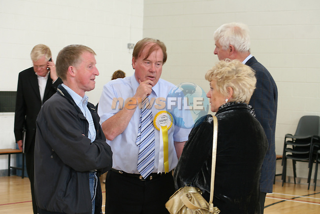 Frank Godfrey (centre) just before it was announced that he won the final seat over Tommy Byrne at the election count in Drogheda Institute of Further Education this evening...Photo NEWSFILE/Jenny Matthews.(Photo credit should read Jenny Matthews/NEWSFILE)....This Picture has been sent you under the condtions enclosed by:.Newsfile Ltd..The Studio,.Millmount Abbey,.Drogheda,.Co Meath..Ireland..Tel: +353(0)41-9871240.Fax: +353(0)41-9871260.GSM: +353(0)86-2500958.email: pictures@newsfile.ie.www.newsfile.ie.FTP: 193.120.102.198.