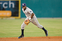 Shortstop Tim Beckham #22 of the Charlotte Stone Crabs tracks a ground ball during a Florida State League game against the Jupiter Hammerheads at Roger Dean Stadium June 15, 2010, in Jupiter, Florida.  Photo by Brian Westerholt /  Seam Images