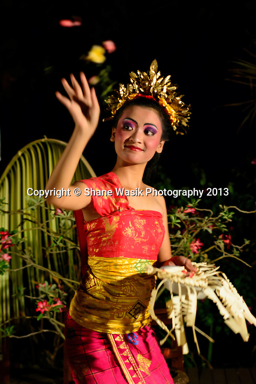 Flower offering during Balinese cultural dance
