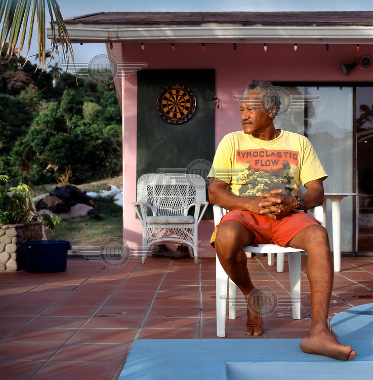 Danny Sweeney, fisherman and former windsurf teacher to visiting celebrities at his house near the exclusion zone. <br /> <br /> Islanders have been greatly affected by the Soufriere Hills volcanic eruption in 1995, which has resulted in up to 7,000 of the 10,500 inhabitants being evacuated from the island. Other residents have been moved to the northernmost areas, while the southern region is designated out of bounds to everyone except scientists.