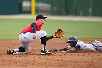 Kannapolis Intimidators shortstop Max Dutto (6) waits for the throw as Anfernee Seymour (9) of the Rome Braves attempts to steal second base at Kannapolis Intimidators Stadium on April 12, 2017 in Kannapolis, North Carolina.  The Braves defeated the Intimidators 4-3.  (Brian Westerholt/Four Seam Images)