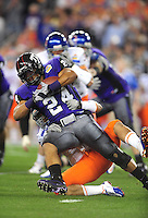 Jan. 4, 2010; Glendale, AZ, USA; TCU Horned Frogs tailback (24) Joseph Turner runs the ball in the first quarter against the Boise State Broncos in the 2010 Fiesta Bowl at University of Phoenix Stadium. Mandatory Credit: Mark J. Rebilas-