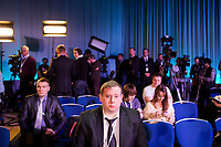 Journalists wait for the arrival of Russian president Vladimir Putin at his annual press conference in Moscow, Russia.  The press conference lasted 5 hours.