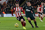 John Fleck of Sheffield United takes the ball away from Ciaran Clark of Newcastle United during the Premier League match at Bramall Lane, Sheffield. Picture date: 5th December 2019. Picture credit should read: James Wilson/Sportimage