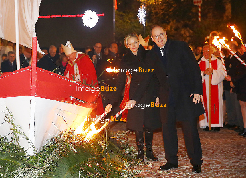 Prince Albert II and Princess Charlene of Monaco attend the mass in Sainte Devote Church before they proceed to the burning of the boat. 'Sainte Devote' is the Holy Patroness of the principality.<br /> Monaco, January 26, 2014.