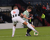 Bahrudin Atajic being tackled by Kerr Young in the Dunfermline Athletic v Celtic Scottish Football Association Youth Cup Final match played at Hampden Park, Glasgow on 1.5.13. ..