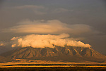 Clouds from afternoon storm gather around the Carizzo Mountains across the Tularosa Valley at sundown.